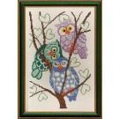stickpackung drie uilen op boomtak